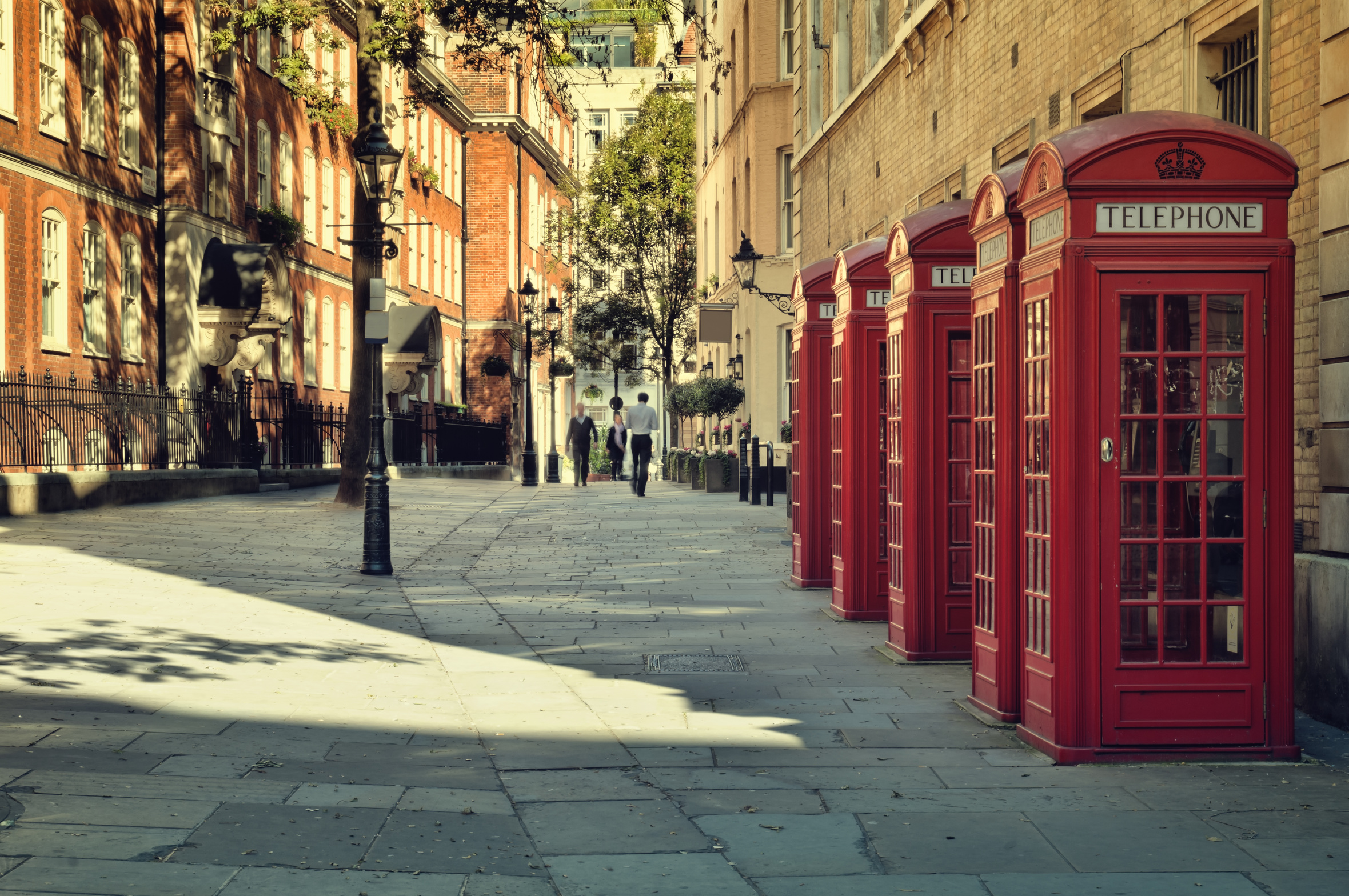 Street with a Tradicional Red Phone Boxes near Covent Garden, London