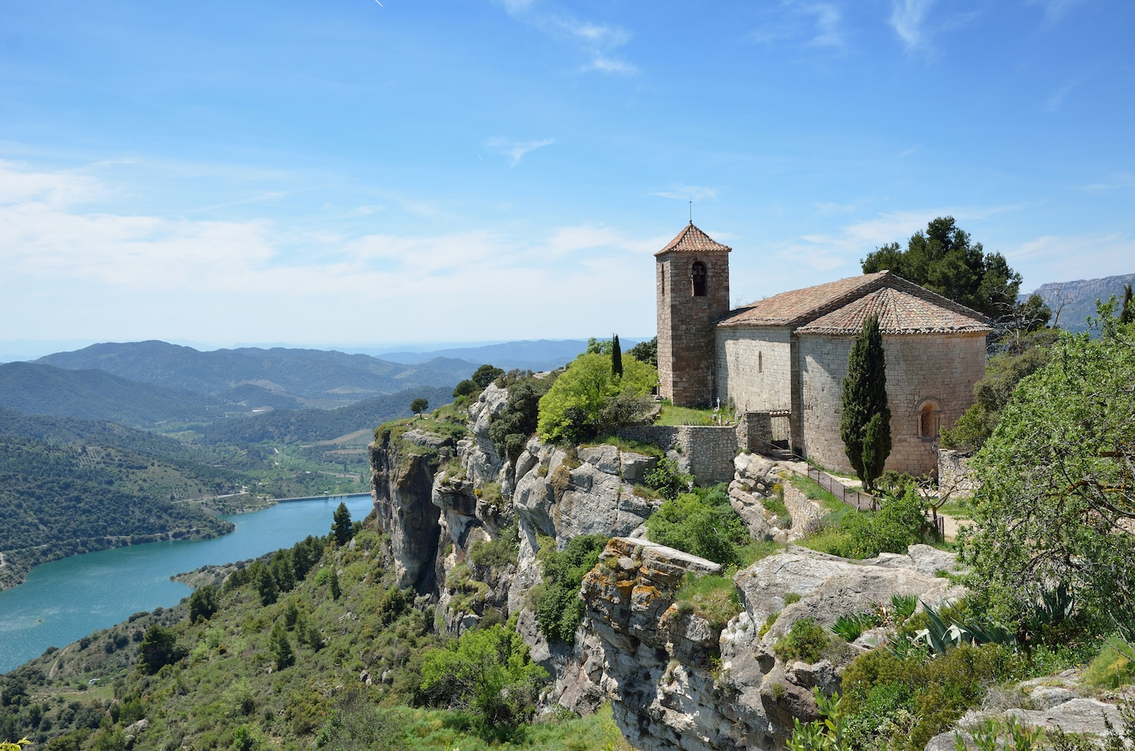 The antique church is extant in the old small village on the bluff cliff under the valley in the Prades Mountains.