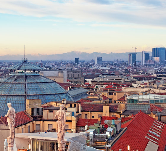 """View of Milan from the rooftoop of  """"Duomo di Milano"""". Statues of  Duomo of Milan, Galleria Vittorio Emanuele II and skycrapert of Porta Nouva als visible."""