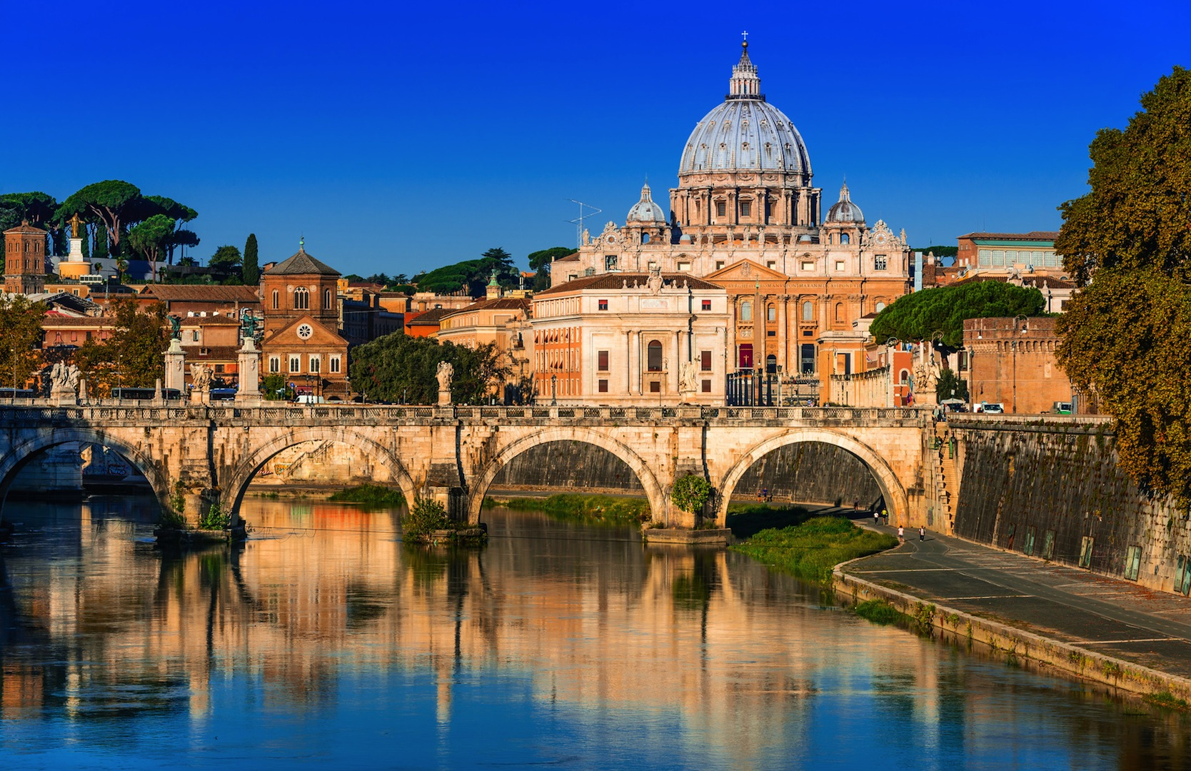 Rome, Italy. Vatican dome of San Pietro and Sant Angelo Bridge, over Tiber river.